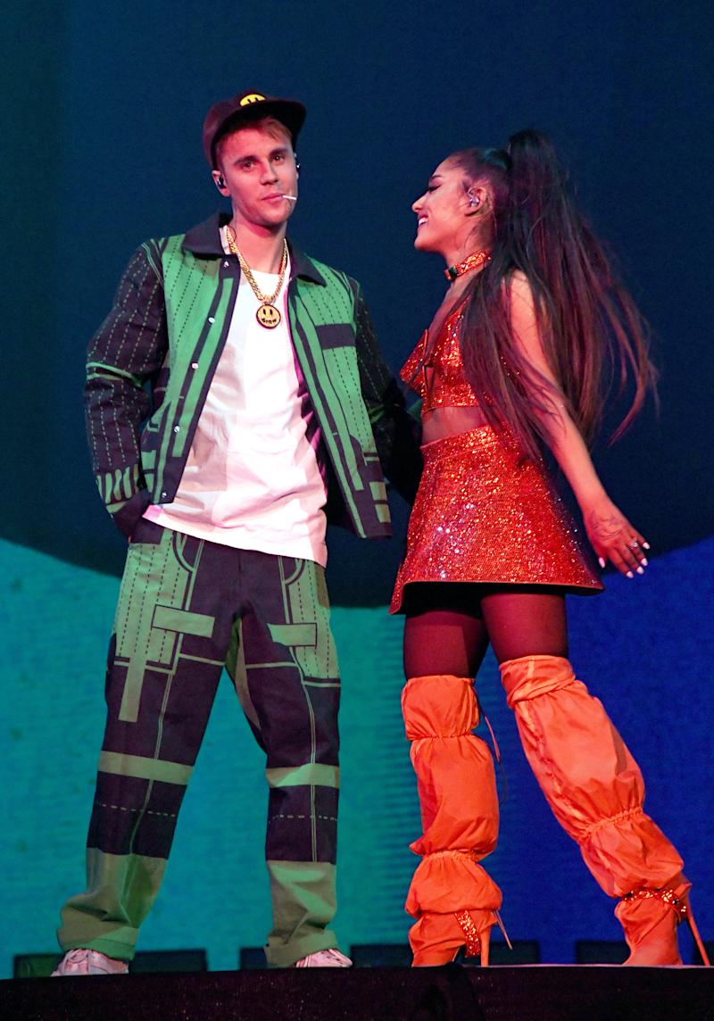 Justin Bieber and Ariana Grande on stage for a performance in green and orange outfits, and they look amazing.
