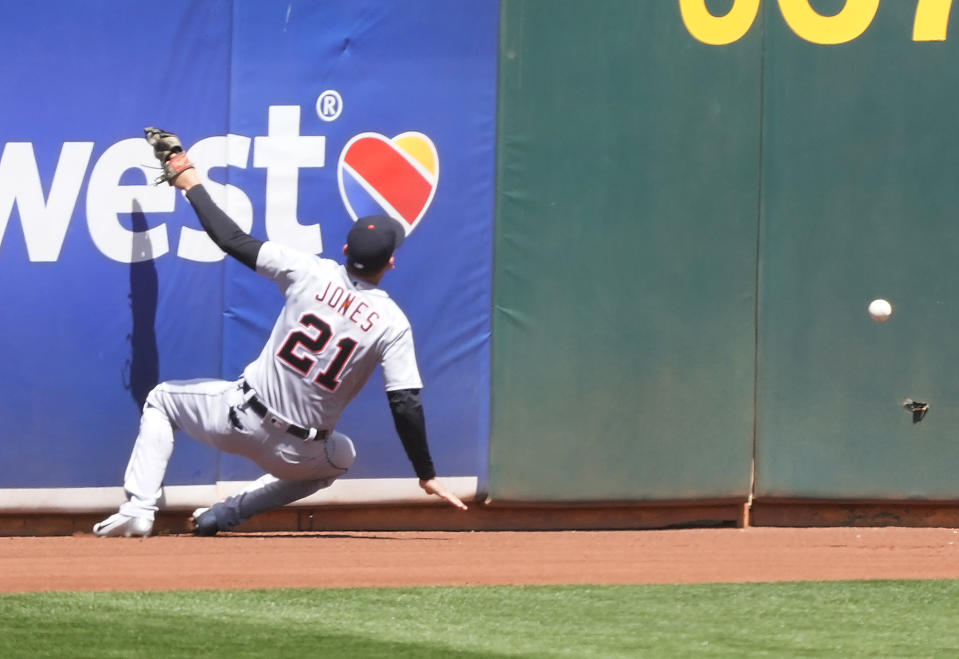 Detroit Tigers left fielder JaCoby Jones (21) cannot make the catch on a triple by Oakland Athletics' Matt Chapman during the first inning of a baseball game on Saturday, April 17, 2021, in Oakland, Calif. (AP Photo/Tony Avelar)