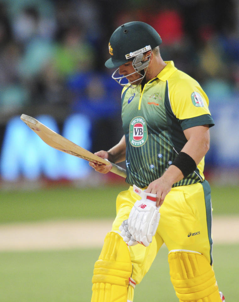 In this photo taken Wednesday, March 12, 2014, Australia's Aaron Finch leaves the field after being dismissed during their rain-delayed T20 cricket match against South Africa in Durban, South Africa. (AP Photo)