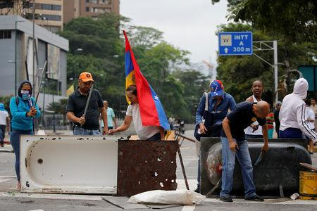 Venezuelans press for elections as protests enter fourth week