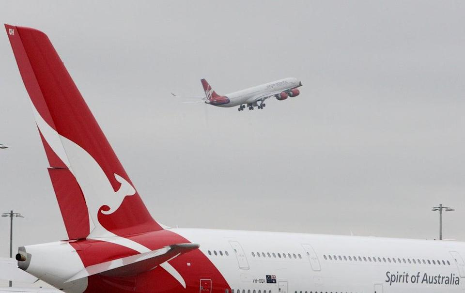 Qantas plans to resume flights between Australian and the UK – and other high-vaccination countries – in December (Steve Parsons/PA) (PA Archive)