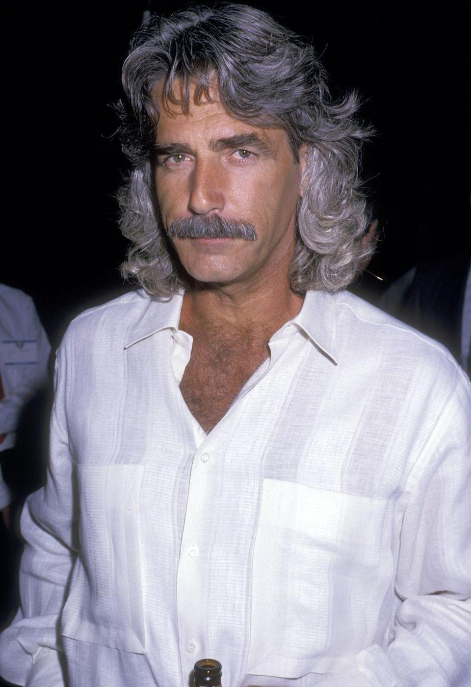 <p>Sam Elliott has been playing Hollywood's tough guy for years, most recently in <em>A Star is Born</em>. But back in 1987, the actor was almost unrecognizable with a long curly mane. </p>