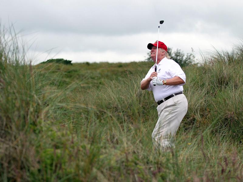 Donald Trump tees off at the The Trump International Golf Links Course in Balmedie, Scotland: Photo by Ian MacNicol/Getty Images