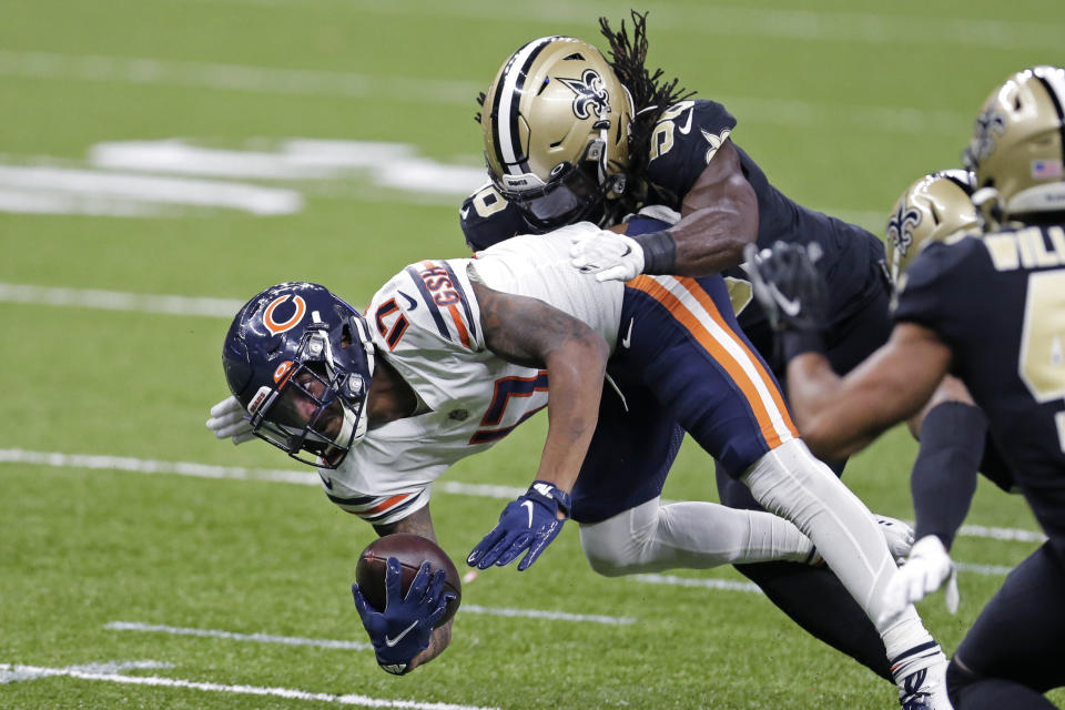 Chicago Bears wide receiver Anthony Miller (17) is tackled by New Orleans Saints outside linebacker Demario Davis (56). (AP Photo/Brett Duke)
