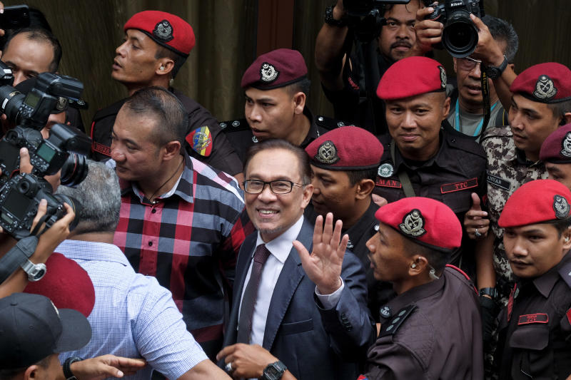 Malaysia's reformist icon Anwar Ibrahim arrives at his house in Kuala Lumpur, Malaysia, Wednesday, May 16, 2018. Malaysia's reformist icon Anwar Ibrahim has been freed from custody after receiving a royal pardon, paving the way for a political comeback following his alliance's stunning election victory. (AP Photo/Sadiq Asyraf)