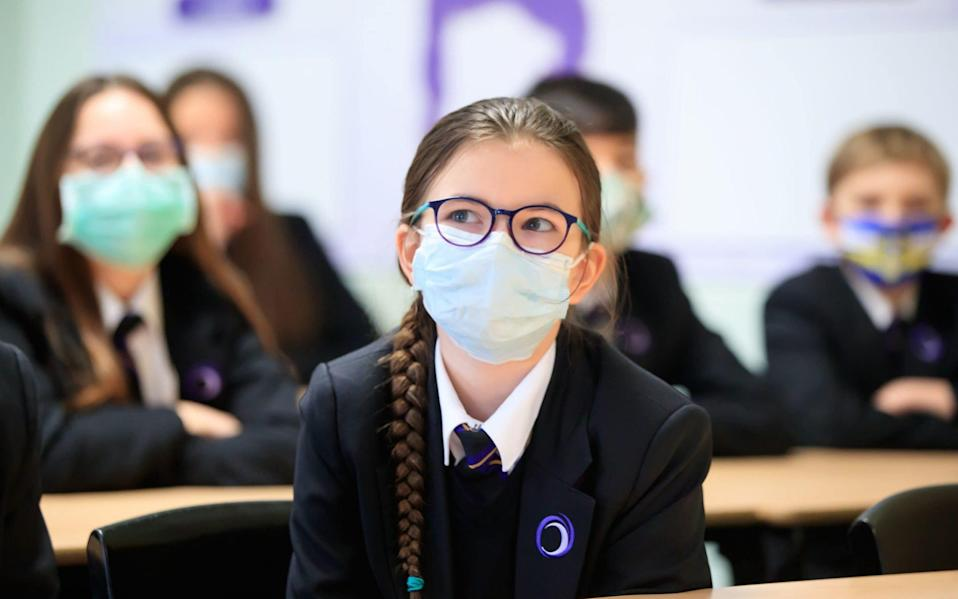 Children wearing facemasks during a lesson at Outwood Academy in Woodlands, Doncaster in Yorkshire - Danny Lawson/PA