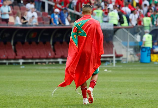 Soccer Football - World Cup - Group B - Portugal vs Morocco - Luzhniki Stadium, Moscow, Russia - June 20, 2018 Morocco's Faycal Fajr walks wrappend in Moroccan flag after the match REUTERS/Maxim Shemetov