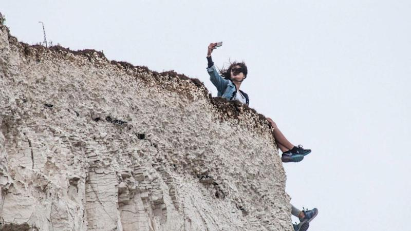 Tourists don't seem fazed by the recent death, heading out to the local cliffs and snapping away. Source: Yahoo