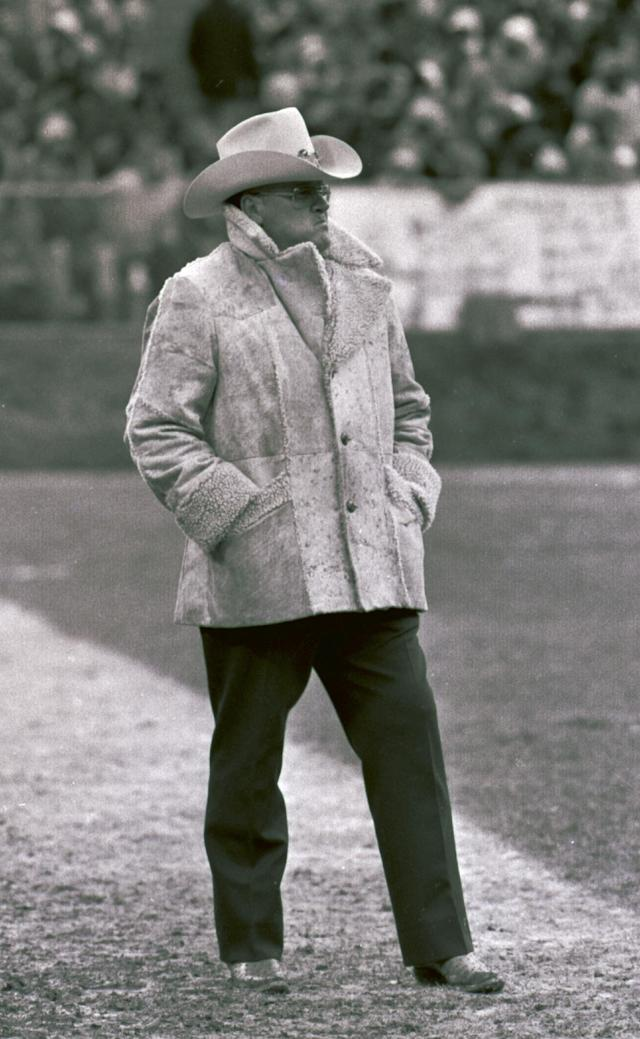 In this Dec. 2, 1979, photo, Houston Oilers coach Bum Phillips stands on the sideline during an NFL football game against the Cleveland Browns in Cleveland. Phillips, the folksy Texas football icon who coached the Oilers during their Luv Ya Blue heyday and also led the New Orleans Saints, died Friday, Oct. 18, 2013. He was 90. (AP Photo)
