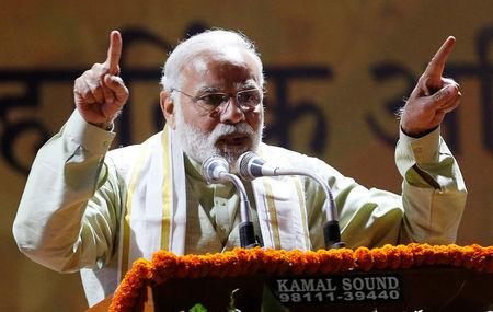 India's Prime Minister Narendra Modi addresses his supporters at Bharatiya Janata Party (BJP) headquarters in New Delhi