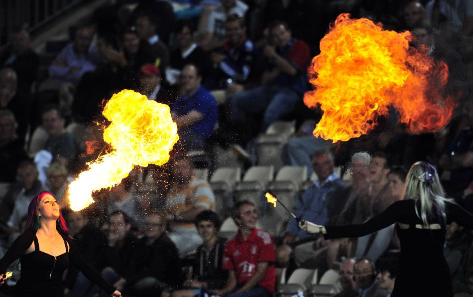A fire-breather entertains the crowd during the Twenty20 International cricket match between England and Australia at the Ageas Bowl in Southampton, southern England, on August 29, 2013. AFP PHOTO/GLYN KIRK