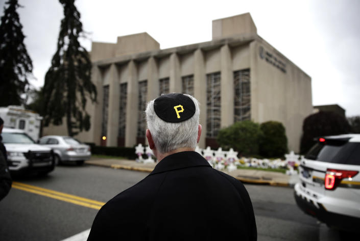 Rabbi Jeffrey Myers of the Tree of Life synagogue stands outside the Pittsburgh temple wearing a yarmulke with a Pittsburgh Pirates logo on Monday. (Photo: Matt Rourke/AP)