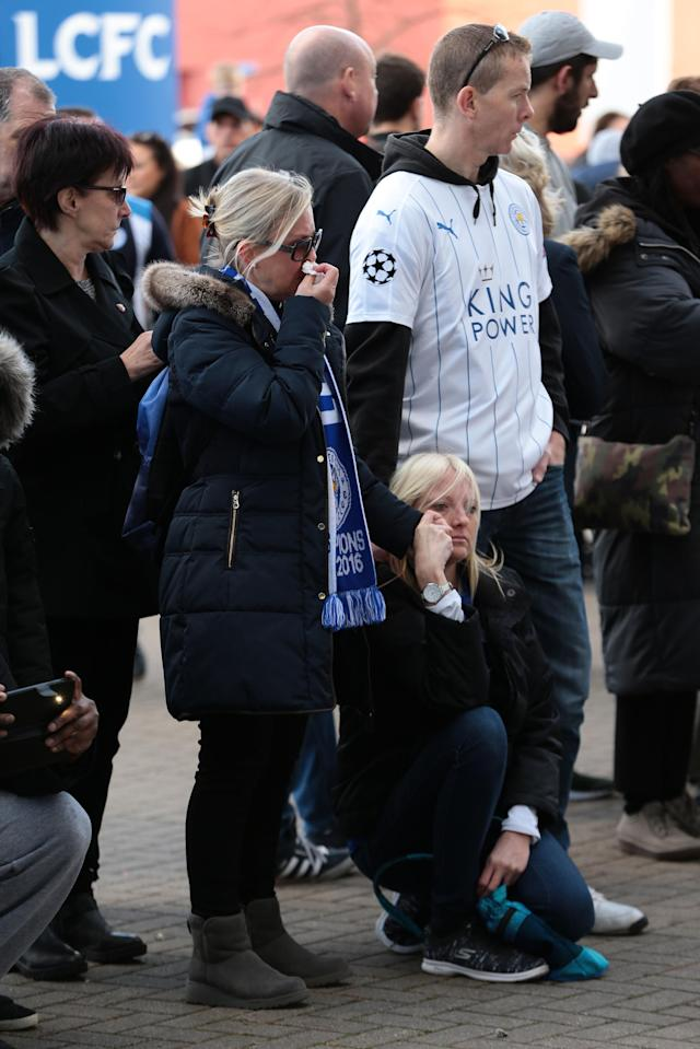 <p>Supporters pay tribute to the Leicester City owner after the crash which killed five people. Aaron Chown/PA Wire </p>