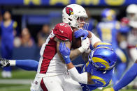 Arizona Cardinals tight end Maxx Williams, left, catches a touchdown next to Los Angeles Rams safety Taylor Rapp during the first half in an NFL football game Sunday, Oct. 3, 2021, in Inglewood, Calif. (AP Photo/Jae C. Hong)