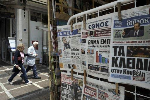 Newspapers featuring the political impasse are displayed at a kiosk in Athens May 11. Greece's president was set Saturday to call last-ditch talks in a bid to forge an emergency unity government and avoid fresh elections, after the main parties failed to form a working coalition