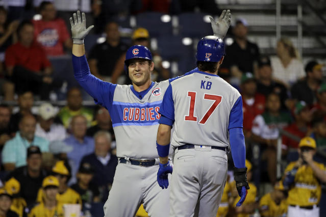 Chicago Cubs' Anthony Rizzo, left, celebrates with Kris Bryant (17) after hitting a two-run home run off Pittsburgh Pirates relief pitcher Chris Stratton during the fifth inning of the Little League Classic baseball game at Bowman Stadium in Williamsport, Pa., Sunday, Aug. 18, 2019. (AP Photo/Tom E. Puskar)