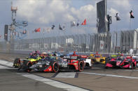 Conor Daly (20) leads a pack into Turn 1 during an IndyCar auto race Sunday, Oct. 25, 2020, in St. Petersburg, Fla. (AP Photo/Mike Carlson)