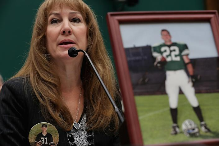 Karen Zegel, whose son Patrick Risha (photograph on the table) took his own life after suffering from chronic traumatic encephalopathy, testifies before the House Energy and Commerce Subcommittee onOversight and Investigations during a hearing about concussions in youth sports in the Rayburn House Office Building on Capitol Hill on May 13, 2016.