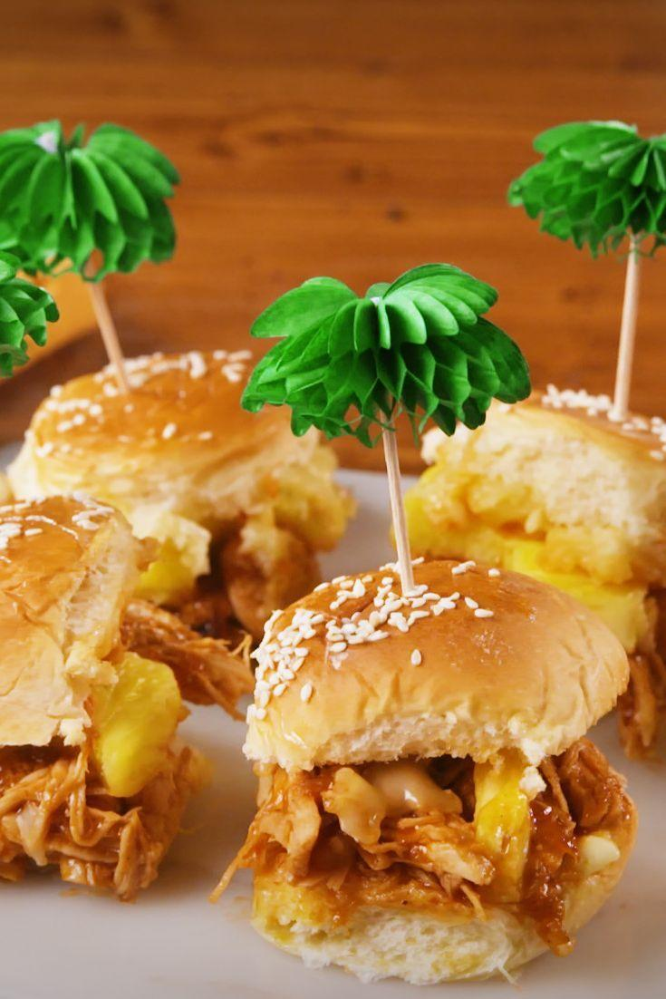 """<p>These pulled pork and pineapple sliders will steal the show at any party. </p><p>Get the recipe from <a href=""""https://www.delish.com/cooking/recipe-ideas/a22781509/tropical-bbq-sliders-recipe/"""" rel=""""nofollow noopener"""" target=""""_blank"""" data-ylk=""""slk:Delish"""" class=""""link rapid-noclick-resp"""">Delish</a>. </p>"""