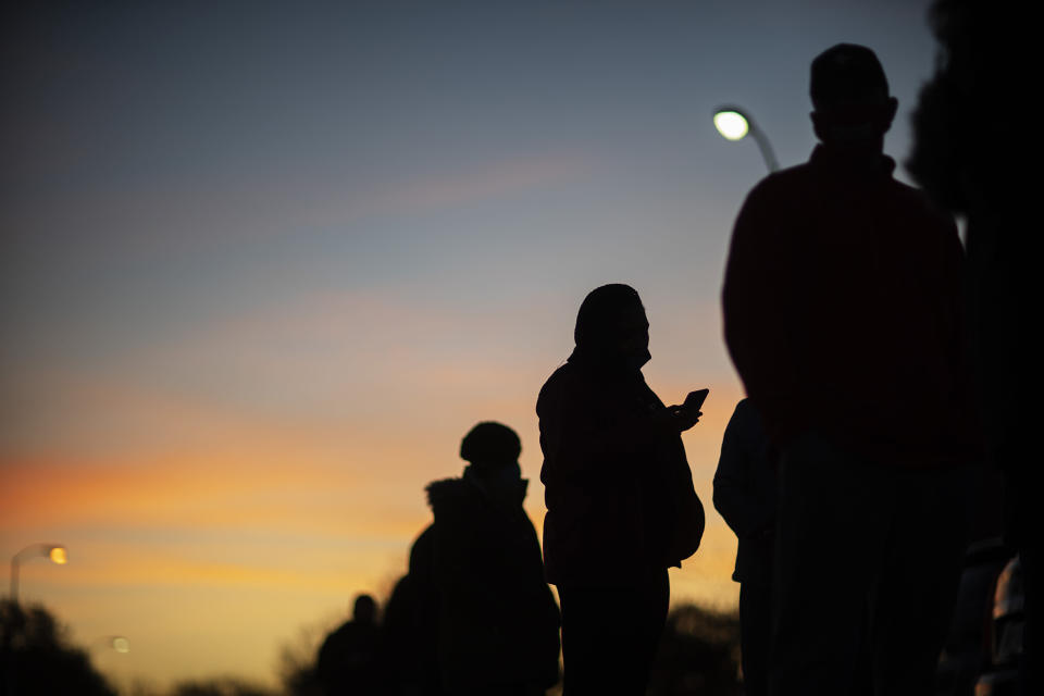 Voters line up before polls open on Election Day at a precinct in Warren, Mich., Tuesday, Nov. 3, 2020. (AP Photo/David Goldman)