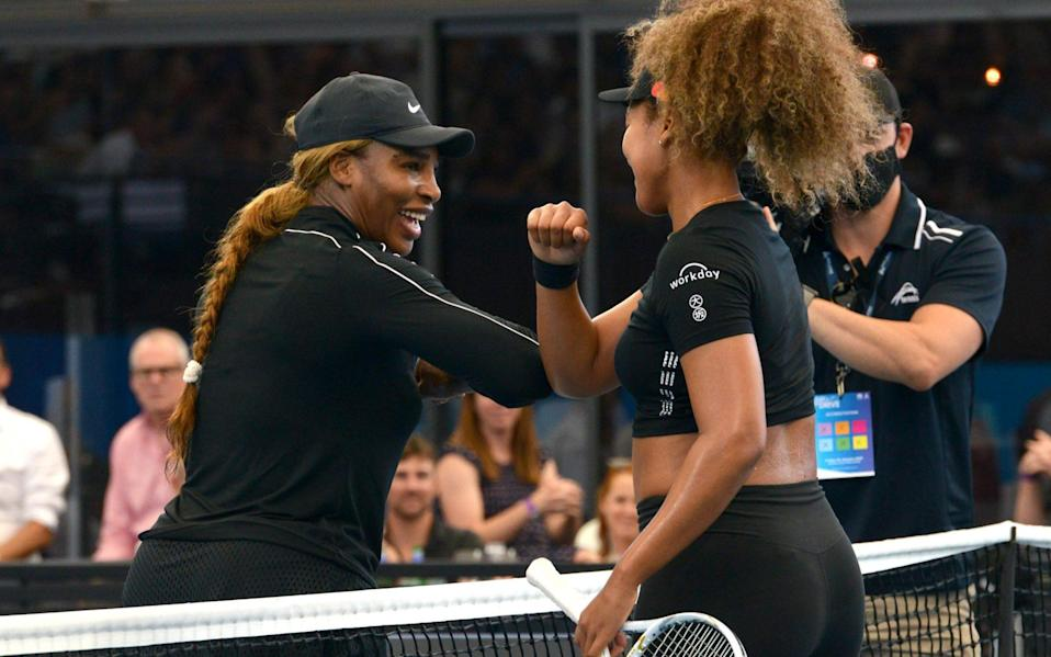 Serena Williams and Naomi Osaka adhere to social distance rules during their show match - AFP