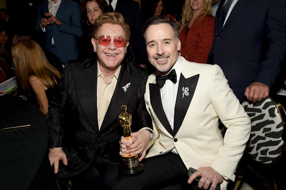 """WEST HOLLYWOOD, CALIFORNIA - FEBRUARY 09: (L-R) Winner of Academy Award for Best Original Song from """"Rocketman"""" Elton John and David Furnish attend the 28th Annual Elton John AIDS Foundation Academy Awards Viewing Party sponsored by IMDb, Neuro Drinks and Walmart on February 09, 2020 in West Hollywood, California. (Photo by Michael Kovac/Getty Images for EJAF)"""