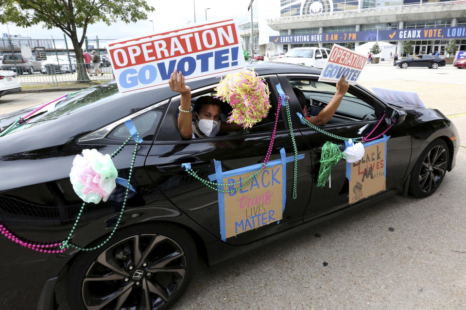 "FILE - In this Oct. 24, 2020, file photo, participants drive past the Smoothie King Center, which has been converted to an early voting location, at the end of a ""Parade to the Polls"" event, organized by Operation Go Vote!, a collaborative of African American civic and social organizations, in New Orleans. Several years since its founding, BLM has evolved well beyond the initial aspirations of its early supporters. Now, its influence faces a test, as voters in the Tuesday, Nov. 3 general election choose or reject candidates who endorsed or denounced the BLM movement amid a national reckoning on race. (AP Photo/Rusty Costanza)"