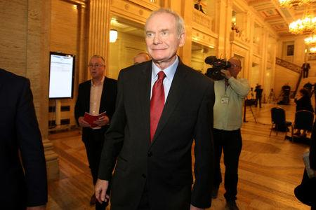 FILE PHOTO: Northern Ireland's former Deputy First Minister Martin McGuinness leaves Assembly at Parliament Buildings in Stormont in Belfast, Northern Ireland, January 16, 2017. REUTERS/Clodagh Kilcoyne/File Photo