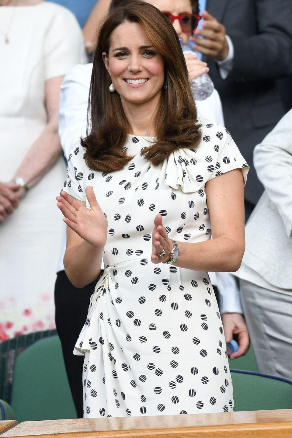 <p>Kate Middleton joined Meghan Markle for Serena Williams' Wimbledon match, choosing a printed dress by Jenny Packham and pearl earrings for the occasion. </p>