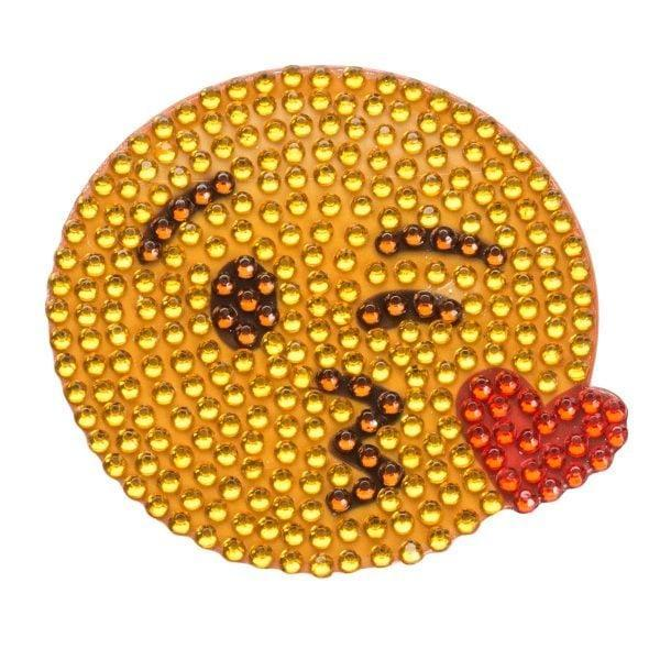 <p>This <span>Kissing Face Emoji Sticker</span> ($4) would look adorable on the back of a laptop or on school books.</p>
