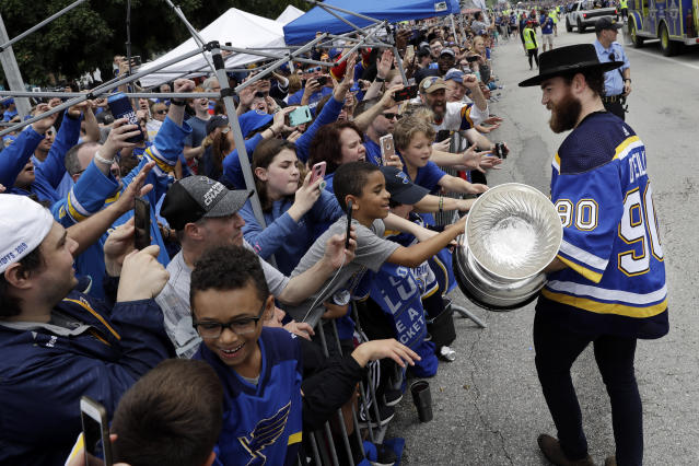 St. Louis Blues center Ryan O'Reilly carries the Stanley Cup during the Blues' NHL hockey Stanley Cup victory celebration in St. Louis on Saturday, June 15, 2019. (AP Photo/Darron Cummings)