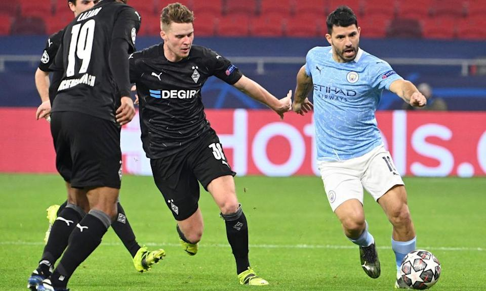 Manchester City's Sergio Agüero, who came on in the second half, runs at the Gladbach defence.