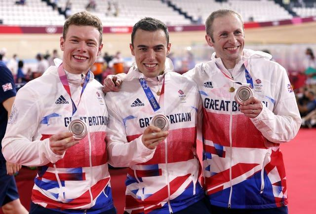 Jack Carlin, Ryan Owens and Jason Kenny pose with their silver medals