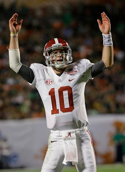 Alabama quarterback AJ McCarron celebrates during the second half of the BCS National Championship college football game against Notre Dame Monday, Jan. 7, 2013, in Miami. (AP Photo/David J. Phillip)