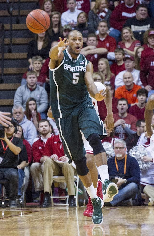 Michigan State's Adreian Payne (5) fires a pass up court in the first half of an NCAA college basketball game against Indiana, Saturday, Jan. 4, 2014, in Bloomington, Ind. (AP Photo/Doug McSchooler)