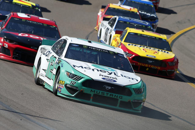 Ryan Blaney (12) leads the field out of Turn 4 during the NASCAR Cup Series auto race at ISM Raceway, Sunday, March 10, 2019, in Avondale, Ariz. (AP Photo/Ralph Freso)