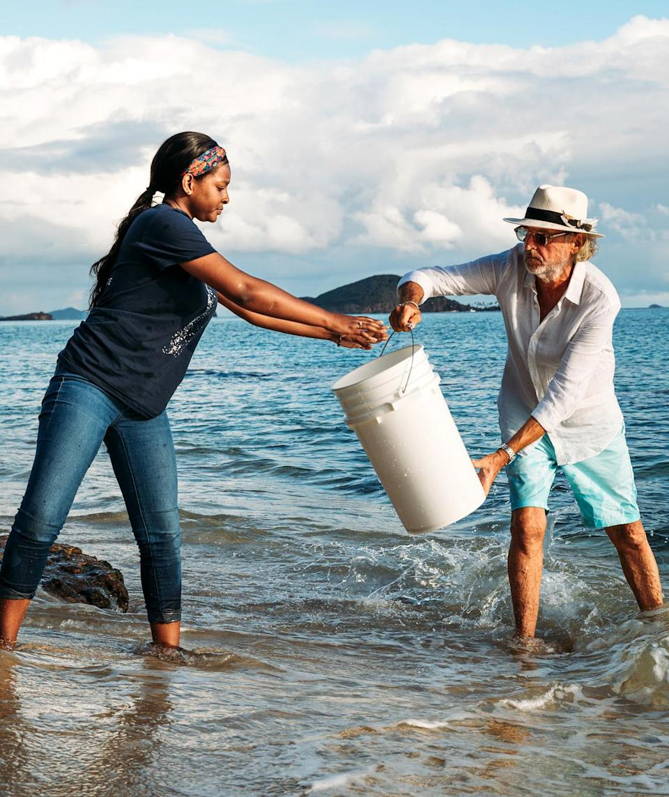 <p>Jerry Simpson harvests seawater with employee Tianna Byron.</p>