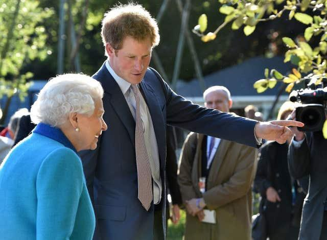 Harry with his grandmother the Queen at the Chelsea Flower Show in 2015