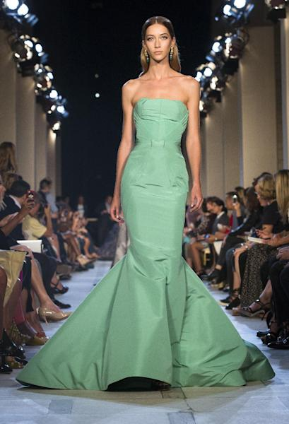 FILE - This Sept. 9, 2012 file photo shows a dress from the Zac Posen Spring 2013 collection during Fashion Week in New York. The rich, vibrant shade of emerald green is Pantone LLC's Color of the Year for 2013, beating out all the other shades of the rainbow. (AP Photo/John Minchillo, file)