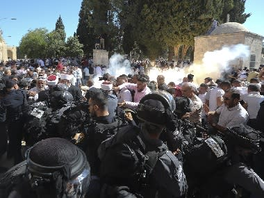 14 wounded in clashes between Muslim worshippers and Israeli Police at disputed holy site in Jerusalem