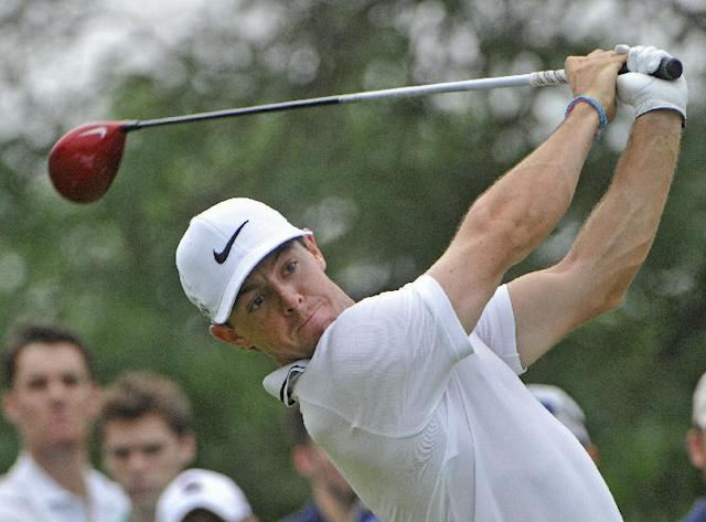 Rory McIlroy watches his tee shot on the 14th hole, during the third round of the Bridgestone Invitational golf tournament, Saturday, Aug. 2, 2014, in Akron, Ohio. (AP Photo/Phil Long)