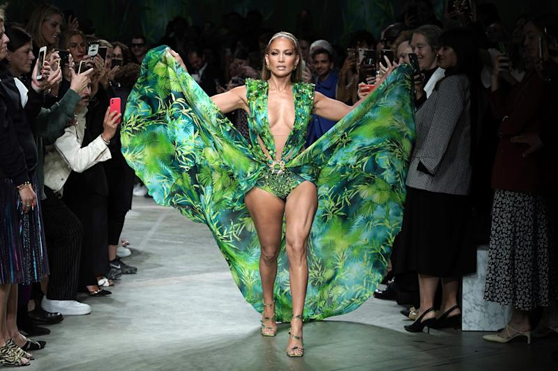 Jennifer Lopez walks in a Versace dress