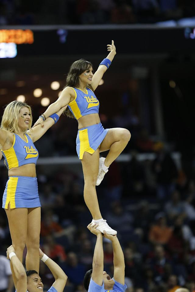 UCLA cheerleaders perform during the first half in a regional semifinal game against Florida at the NCAA college basketball tournament, Thursday, March 27, 2014, in Memphis, Tenn.(AP Photo/John Bazemore)