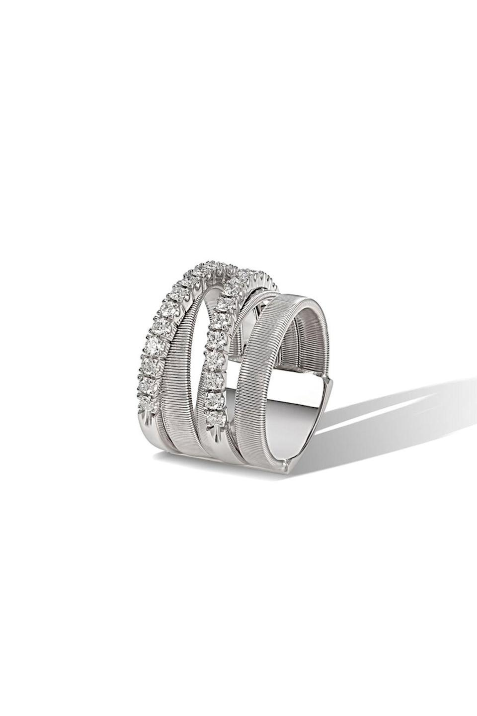 """<p><strong>Marco Bicego</strong></p><p>marcobicego.com</p><p><strong>$7160.00</strong></p><p><a href=""""https://us.marcobicego.com/products/masai-five-strand-white-gold-and-diamond-ring"""" rel=""""nofollow noopener"""" target=""""_blank"""" data-ylk=""""slk:Shop Now"""" class=""""link rapid-noclick-resp"""">Shop Now</a></p><p>A five strand ring that takes cues from the African Masai tribe's ornamentation, Marco Bicego's design wraps sinuously around the finger.</p>"""