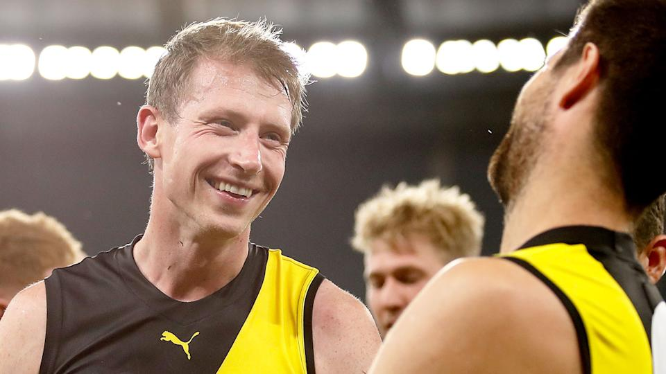 Pictured here, Richmond star Dylan Grimes has been the target of abuse from rival fans.