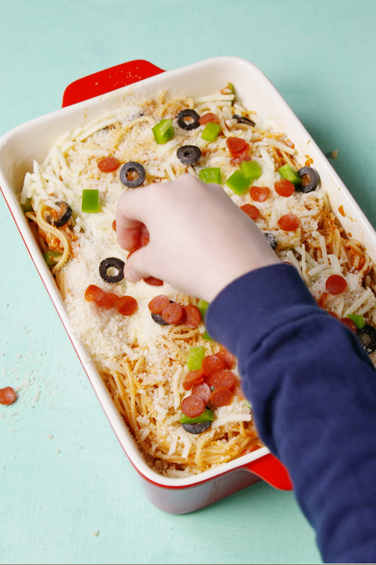 """<p>Pizza and spaghetti are meant to be—your kids will agree!</p><p>Get the recipe from <a href=""""https://www.delish.com/cooking/recipe-ideas/recipes/a57807/pizza-spaghetti-recipe/"""" rel=""""nofollow noopener"""" target=""""_blank"""" data-ylk=""""slk:Delish"""" class=""""link rapid-noclick-resp"""">Delish</a>. </p>"""