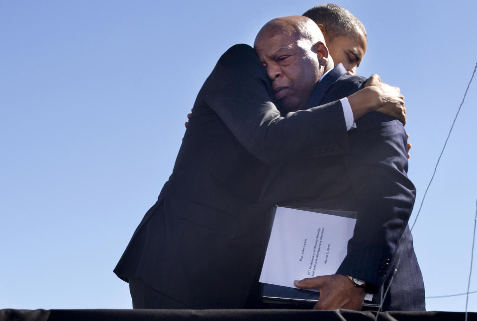"""President Barack Obama embraces Rep. John Lewis, D-Ga., after Lewis introduced the president with an emotional speech by the Edmund Pettus Bridge in Selma, Ala., on the 50th anniversary of """"Bloody Sunday,"""" a landmark event of the civil rights movement, Saturday, March 7, 2015. (Phhoto: Jacquelyn Martin/AP)"""