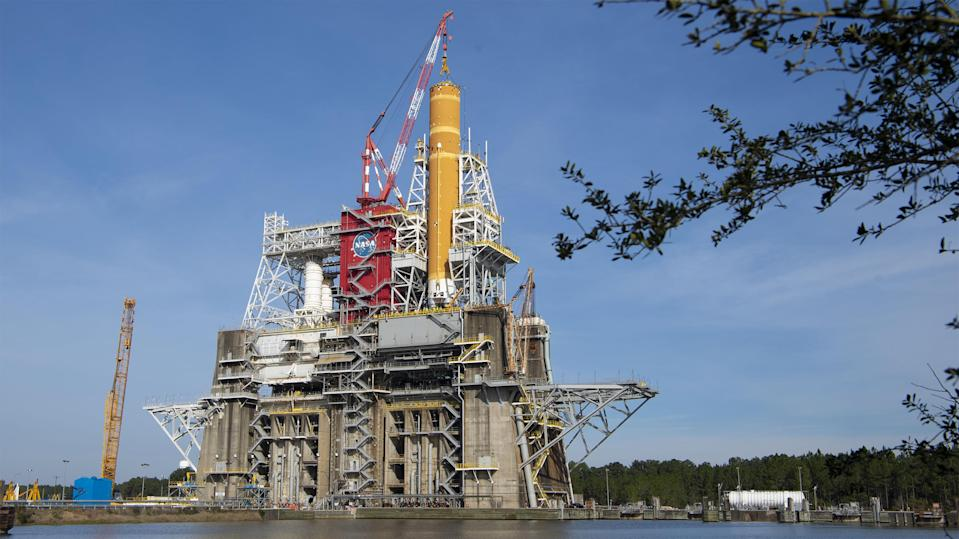 The Space Launch System sits in the middle of NASA's heavy-duty B-2 Test Stand at NASA's Stennis Space Center near Bay St. Louis, Mississippi.
