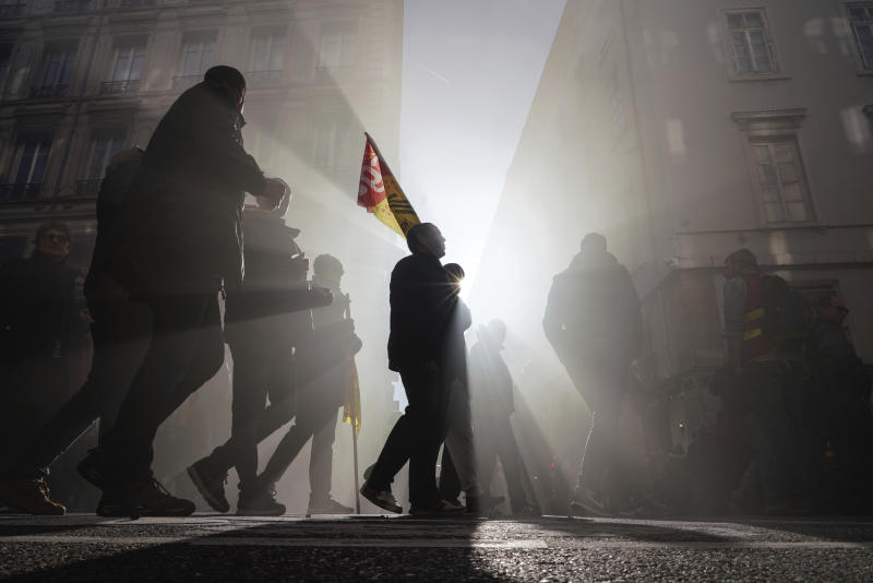 Protesters march during a demonstration in Lyon, central France, Thursday, Jan. 16, 2020. Protesters denounced French President Emmanuel Macron's plans to overhaul the country's pension system. (AP Photo/Laurent Cipriani)