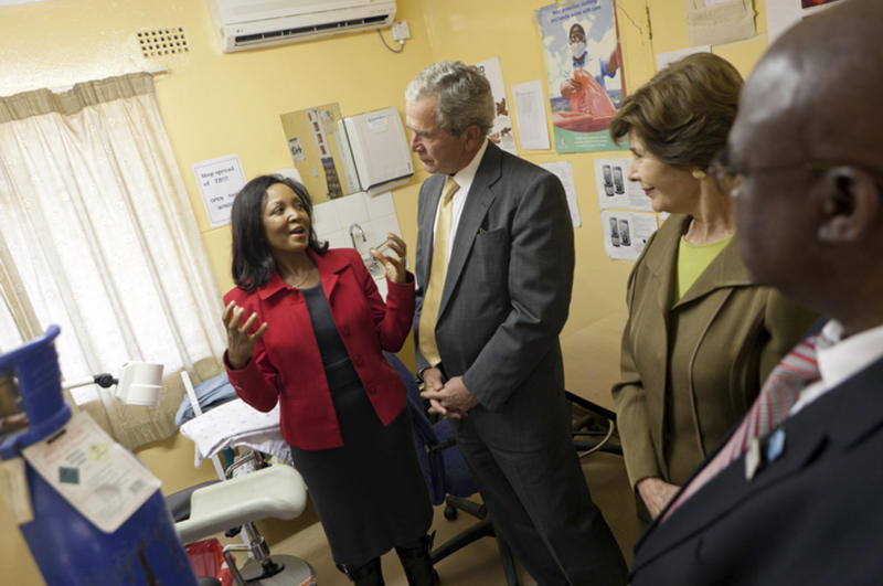 In this photo provided by the George W. Bush Presidential Center, Dr. Doreen Ramogola-Masire, Country Director, Botswana-UPenn Partnership Clinic, leads former President George W. Bush and Laura Bush on a tour of the Bontleng Clinic in Gaborone, Botswana, on Thursday, July 5, 2012. The Bontleng Clinic offers screening for cervical cancer; which is the second most common cancer in Botswana and the leading cause of female related cancer deaths. The former president and his wife visited Africa for a week to promote a partnership between the George W. Bush Institute, the U.S. President's Emergency Plan for AIDS Relief, UNAIDS and Susan G. Komen for the Cure, that aims to fight cervical and breast cancer in sub-Saharan Africa. (AP Photo/George W. Bush Presidential Center, Shealah Craighead)